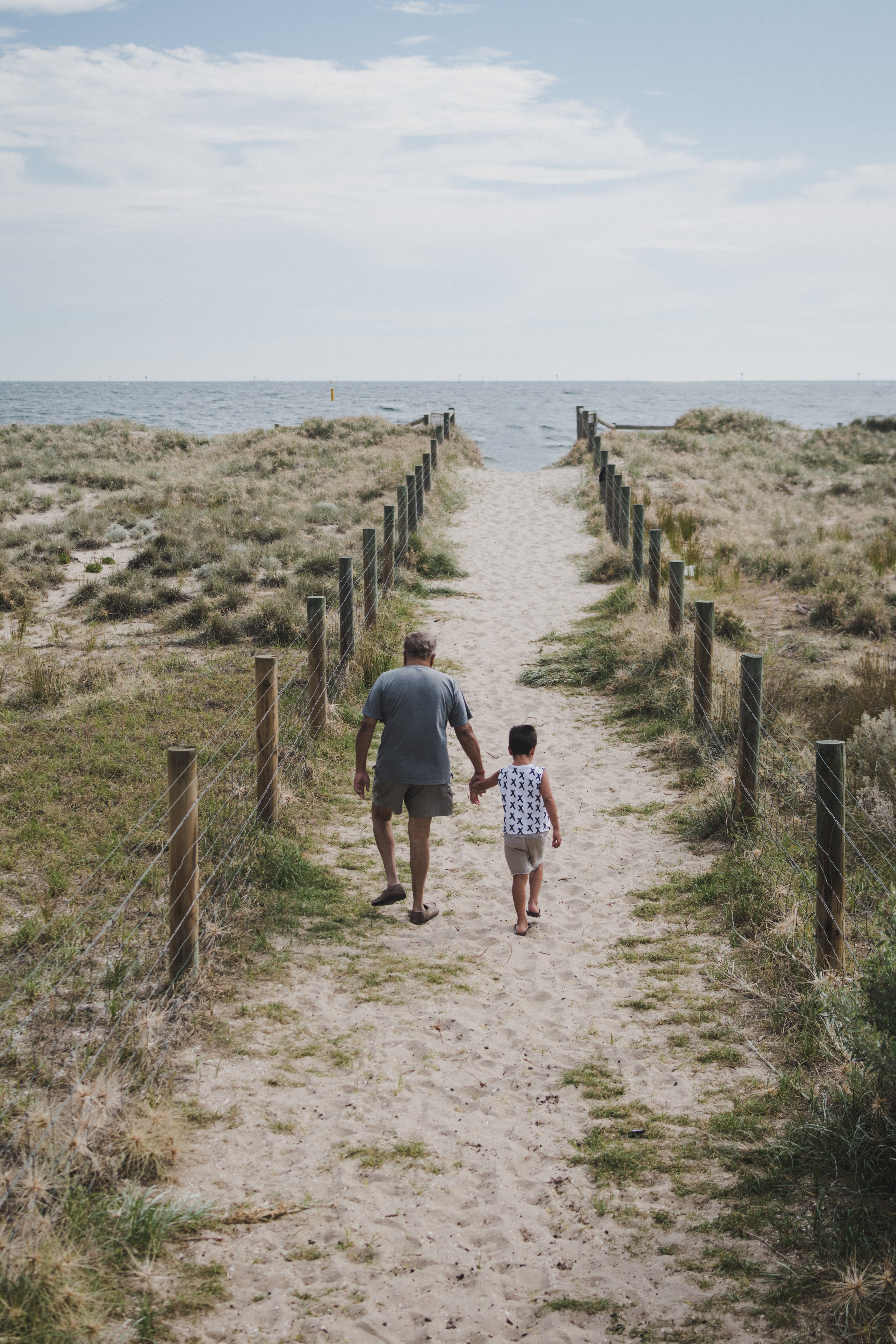 A man and a child taking a walk | Source: Unsplash.com