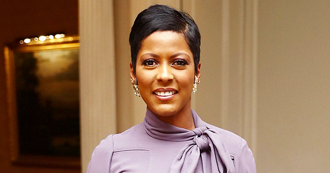See Tamron Hall's Baby Moses Give a 'Hi Five' in Father's Day Photo