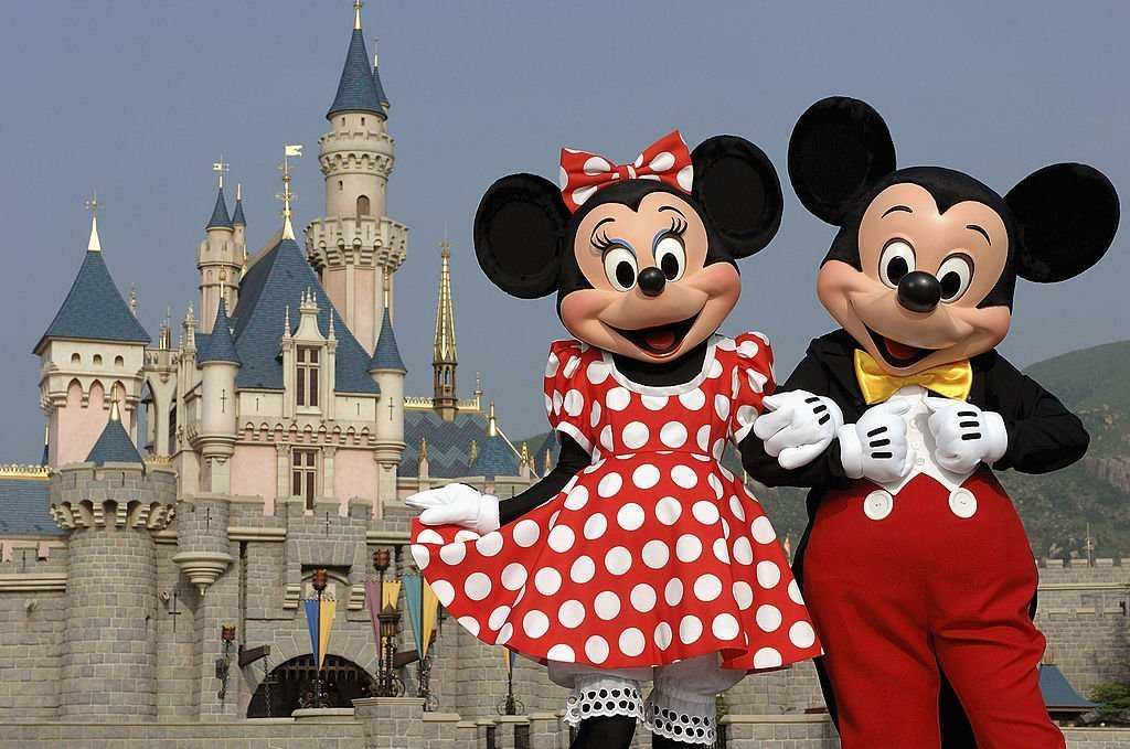 Mickey and Minnie Mouse are seen in front of the Sleeping Beauty Castle at the new Disneyland Park on September 1, 2005 in Hong Kong.  | Getty Images