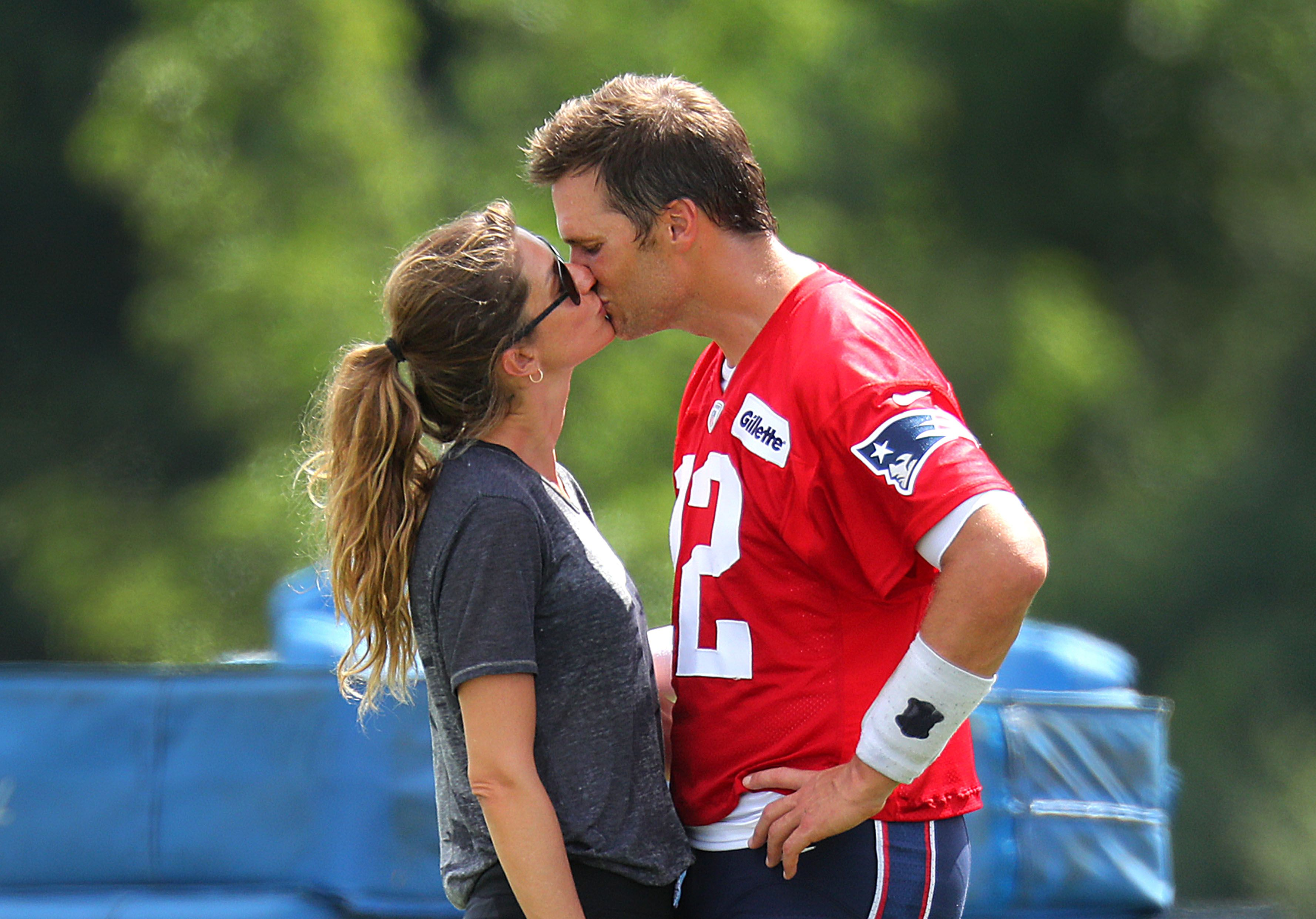 Tom Brady kisses his Gisele Bundchen following Patriots training camp at the Gillette Stadium practice facility in Foxborough, MA on Aug. 3, 2018. | Source: Getty Images
