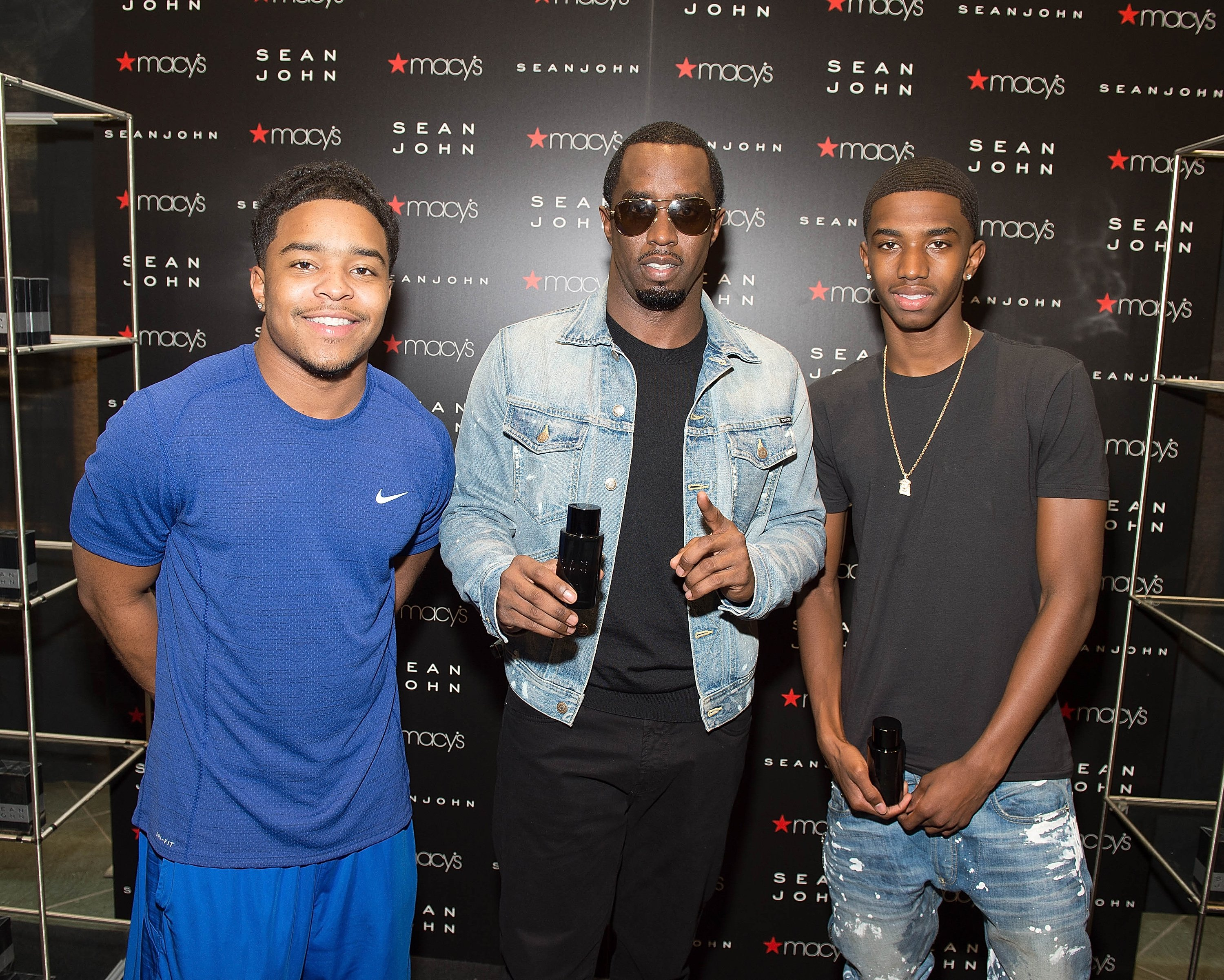 "(L-R) Justin Sean ""Diddy"" Combs, and Christian ""King"" Combs pose during the  Sean John new fragrance launch at Macy's Lenox Square on September 8, 2016 in Atlanta, Georgia. 