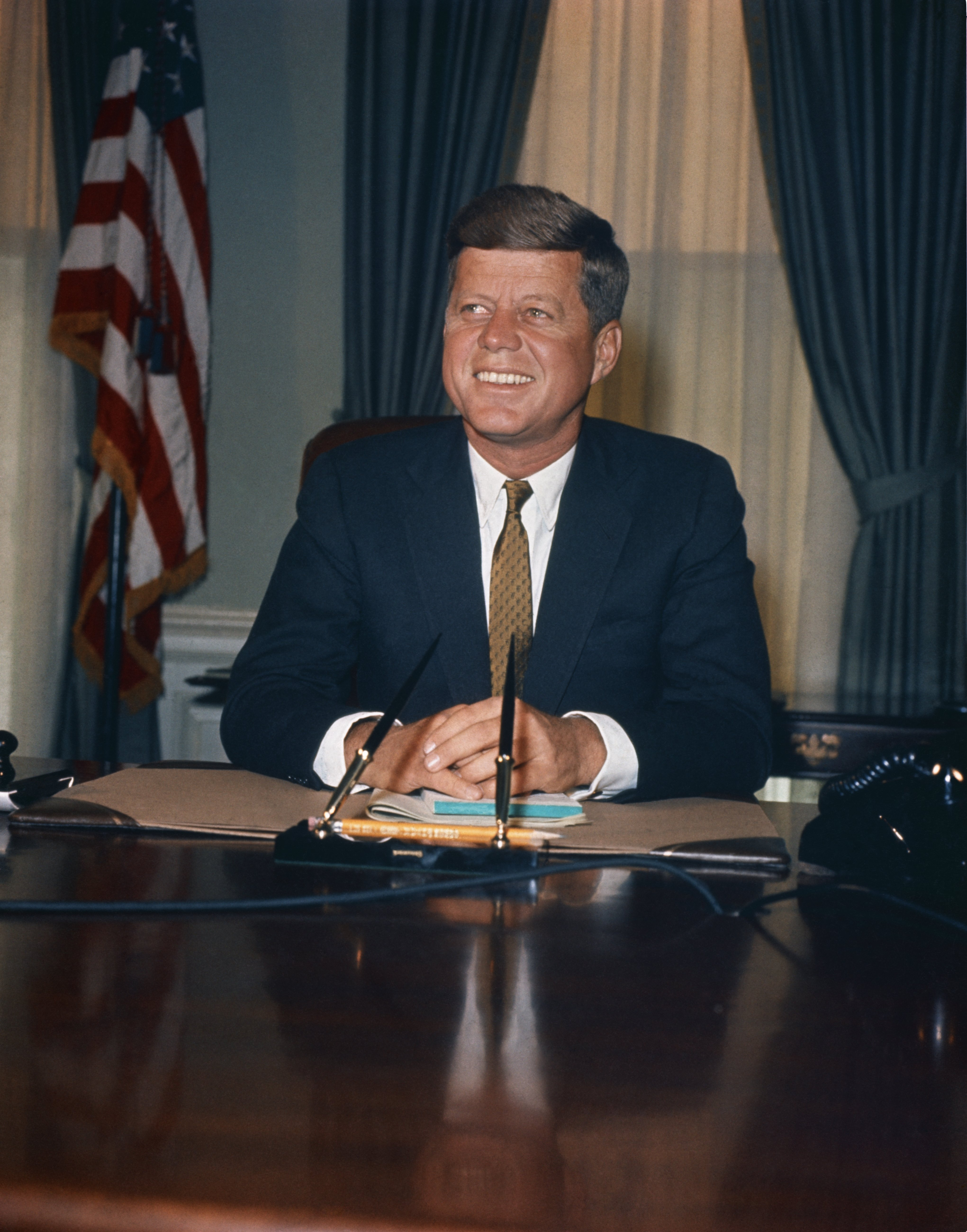 John F. Kennedy pictured at his desk in Oval Office in The White House. | Photo: Getty Images