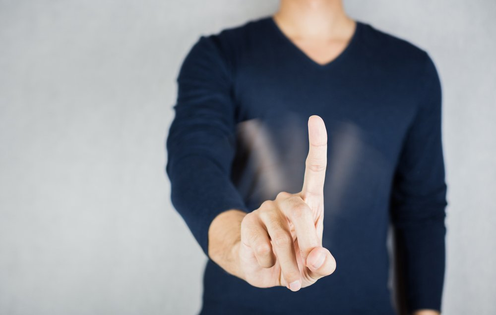 """The motion of waving the index finger to say """"No"""" 