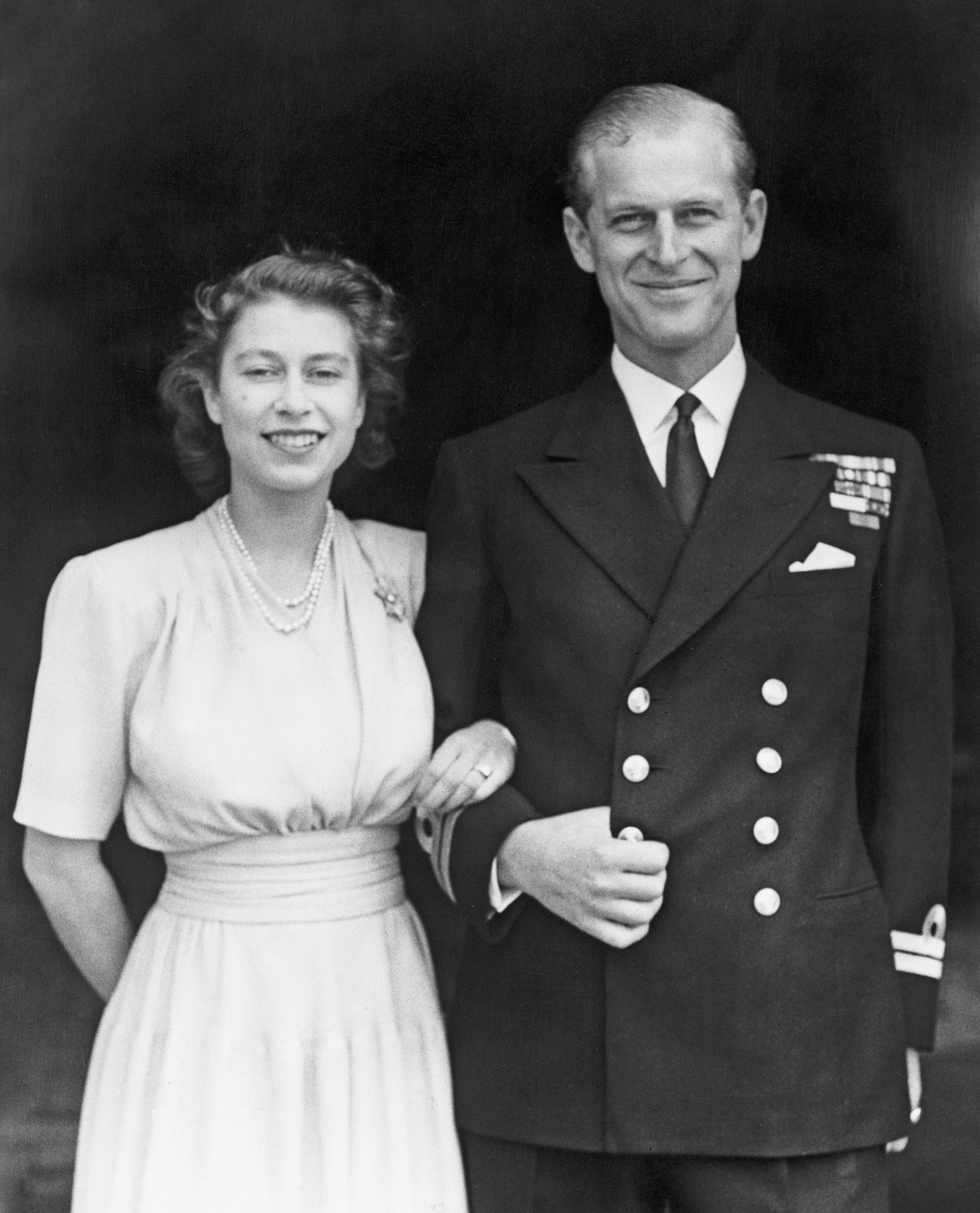 Queen Elizabeth (Princess at time) and Philip Mountbatten, Duke of Edinburgh, on the occasion of their engagement at Buckingham Palace in London in 1947   Photo: Fox Photos/Getty Images
