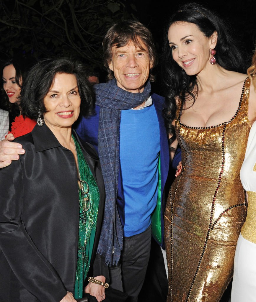 Bianca Jagger, Mick Jagger and L'Wren Scott at the annual Serpentine Gallery Summer Party on June 26, 2013 in London, England | Photo by Dave M. Benett/Getty Images
