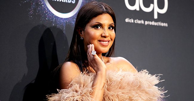 Toni Braxton Looks like a Duchess Posing in Sophisticated Dresses for Harper's Bazaar Cover