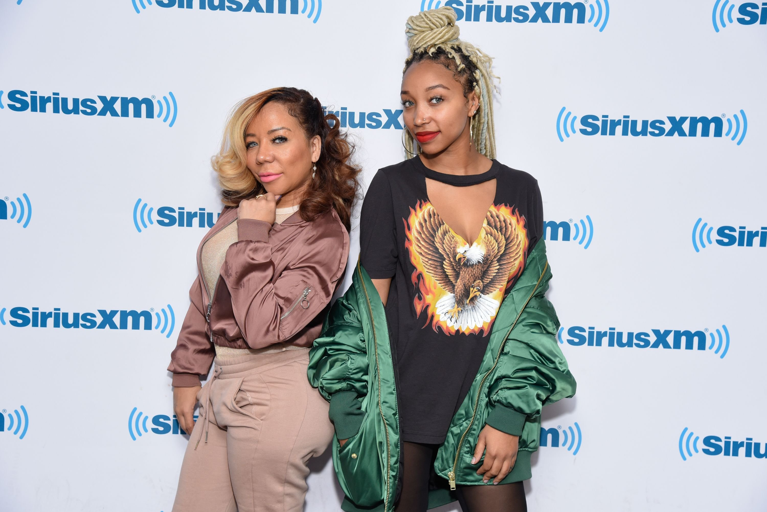 """Tameka """"Tiny"""" Harris (L) and Zonnique Jailee Pullins at the SiriusXM Studios on April 19, 2017 in New York City 