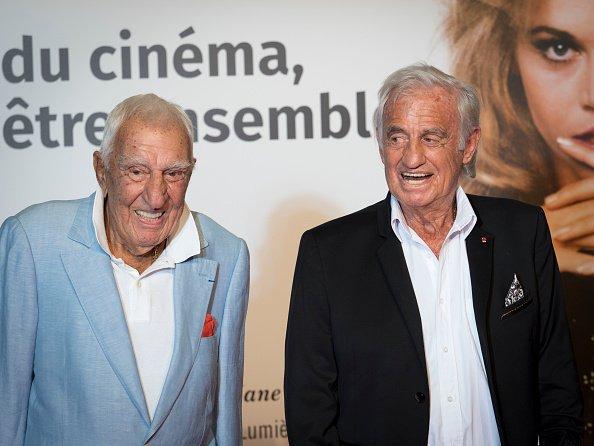 Charles Gérard et Jean-Paul Belmondo à la cérémonie d'ouverture du 10e Festival du film Lumière le 13 octobre 2018 à Lyon, France.  | Photo : Getty Images