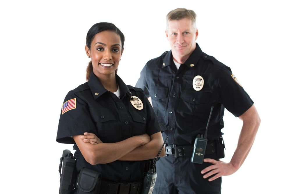 Two American police officers in uniform. | Source: Shutterstock