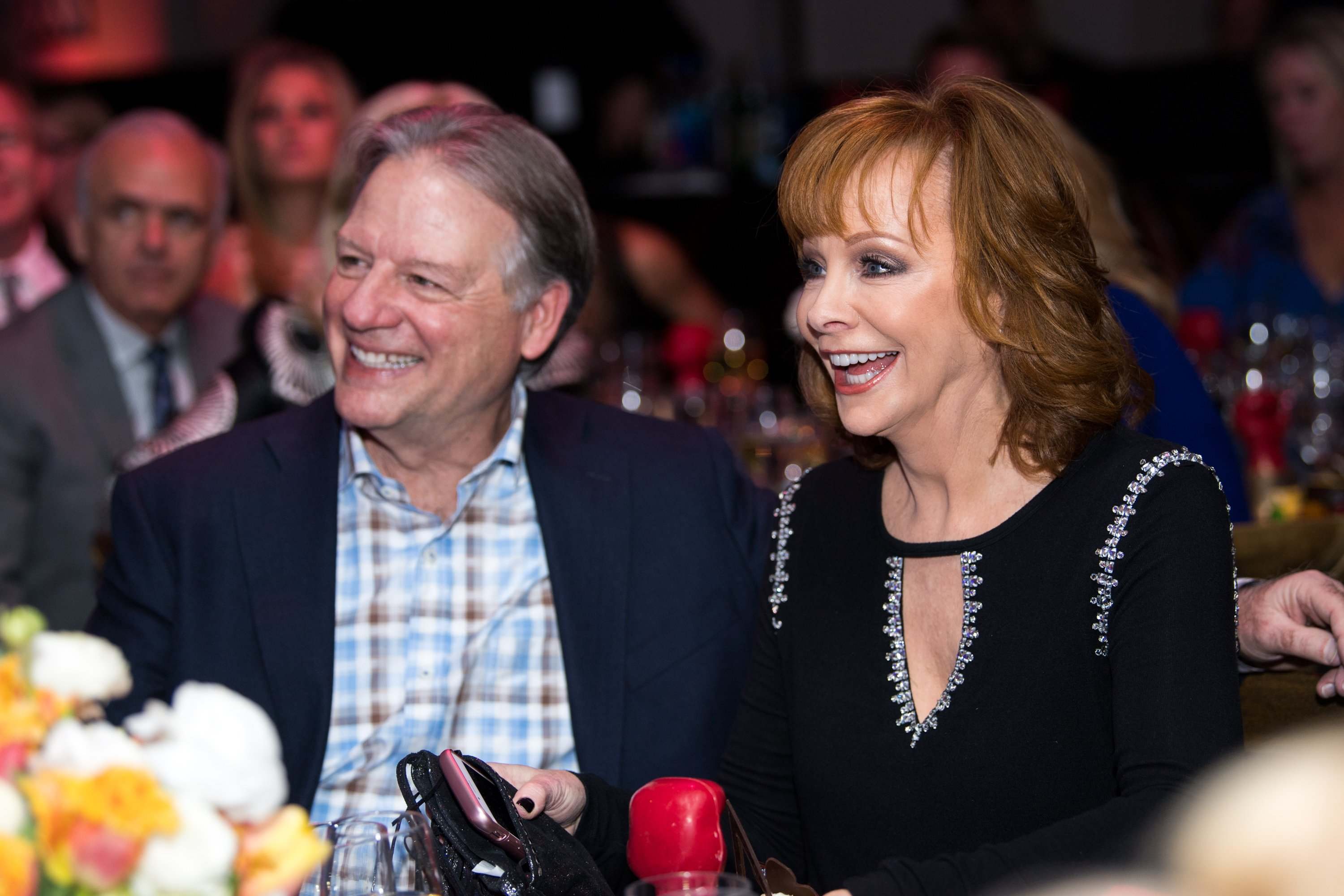 Anthony Lasuzzo (L) and Reba McEntire attend the Celebrity Fight Night's Founders Club Dinner on March 9, 2018, in Phoenix, Arizona. | Source: Getty Images.