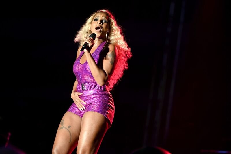 Mary J. Blige performing onstage in a purple bodysuit | Source: Getty Images/GlobalImagesUkraine