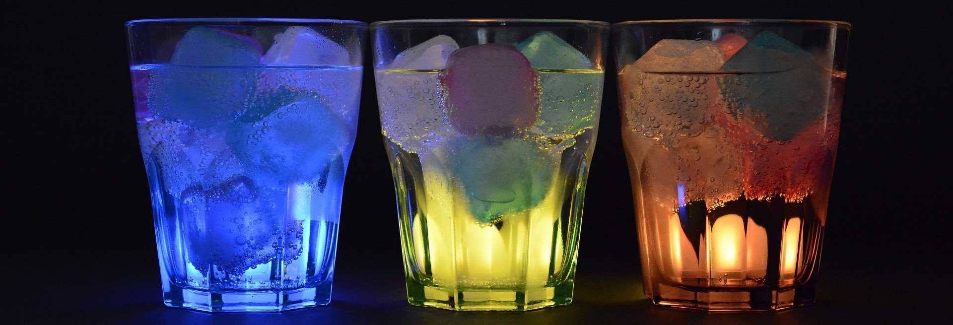 Three glasses with ice lit up in different colors.   Photo: Pixabay/anncapictures