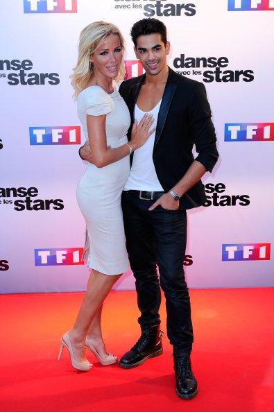 """Ophelie Winter et Christophe Licata assistent au Photocall """"Danse Avec Les Stars 2014"""" à TF1 le 10 septembre 2014 à Paris, France.    Photo : Getty Images"""