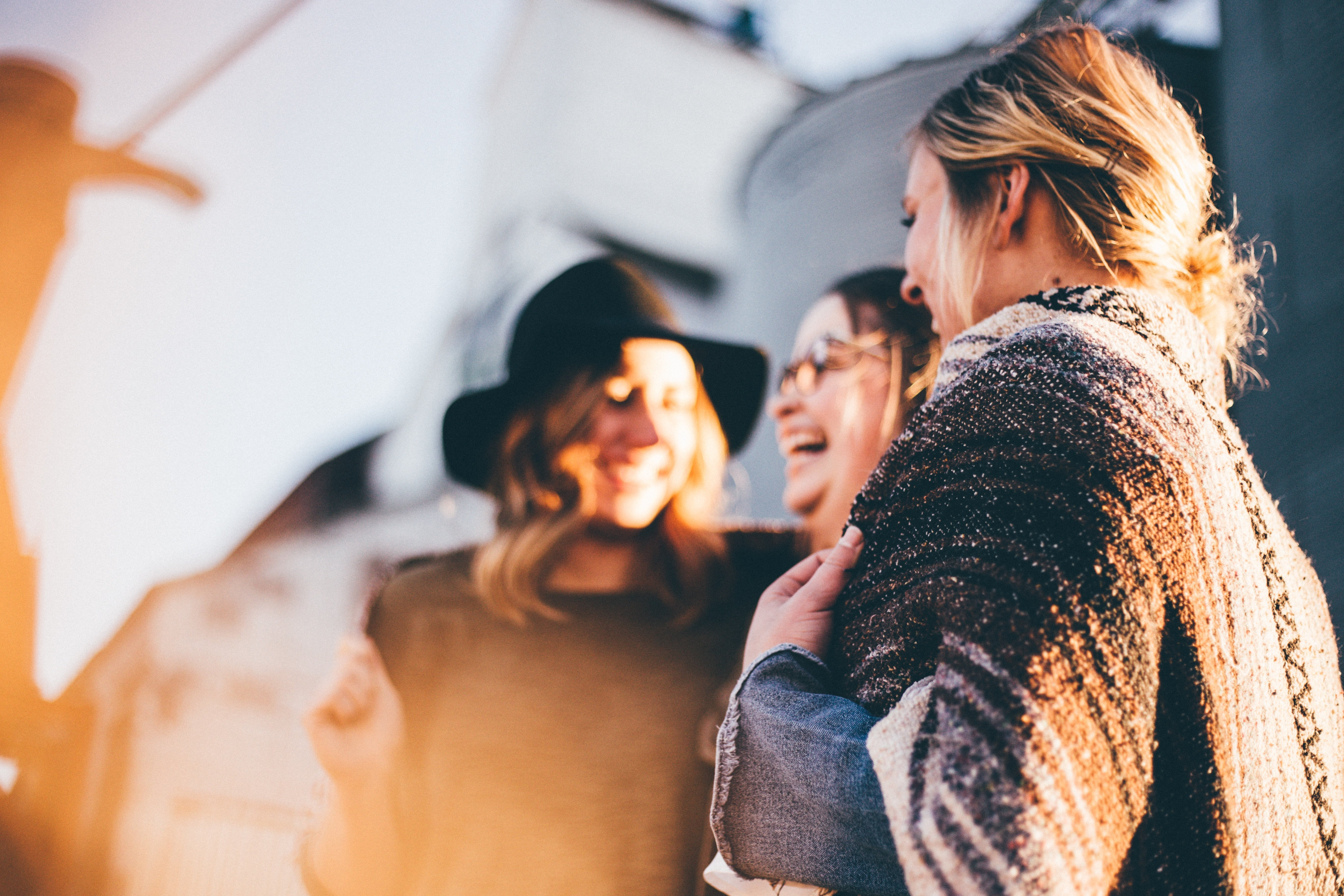 A group of friends laughing at a reunion | Source: Unsplash.com