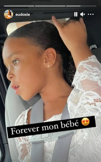 Ludacris' daughter, Cadence, posing for a picture inside a car | Photo: Instagram/eudoxie