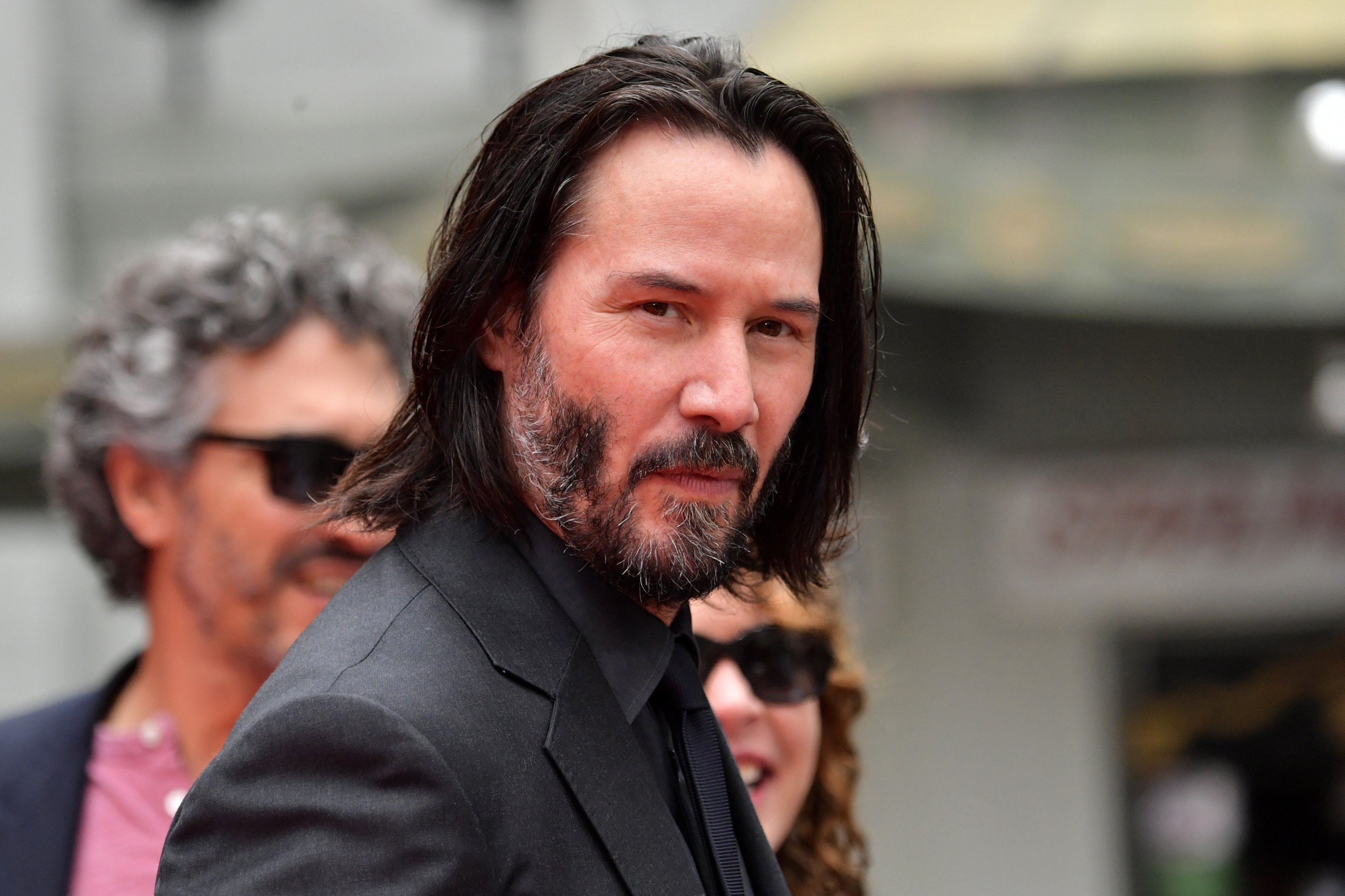 Keanu Reeves arrives for his handprint ceremony on May 14, 2019, in Hollywood, California. | Source: Getty Images.