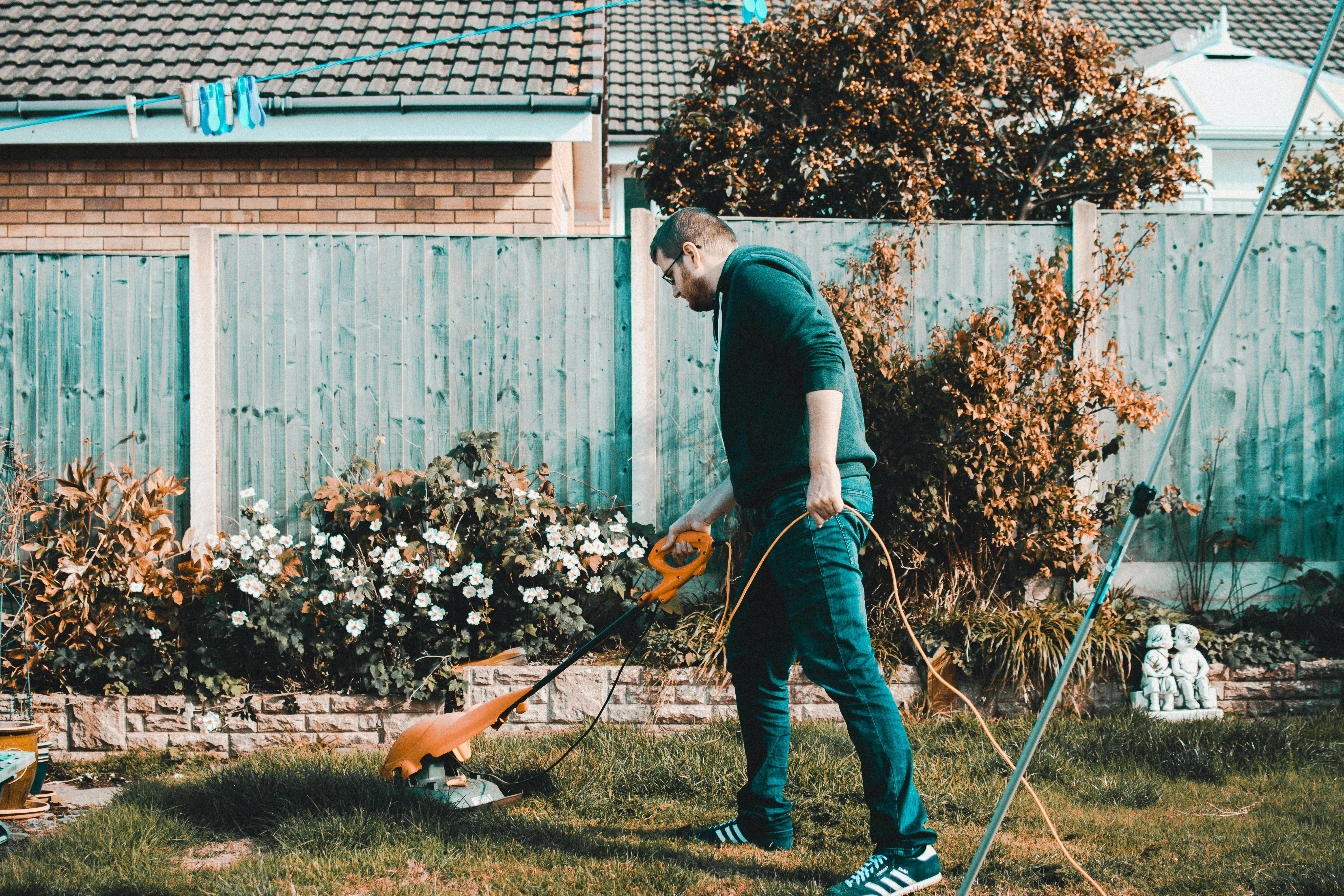 A man mowing the lawn.   Photo: Pixabay