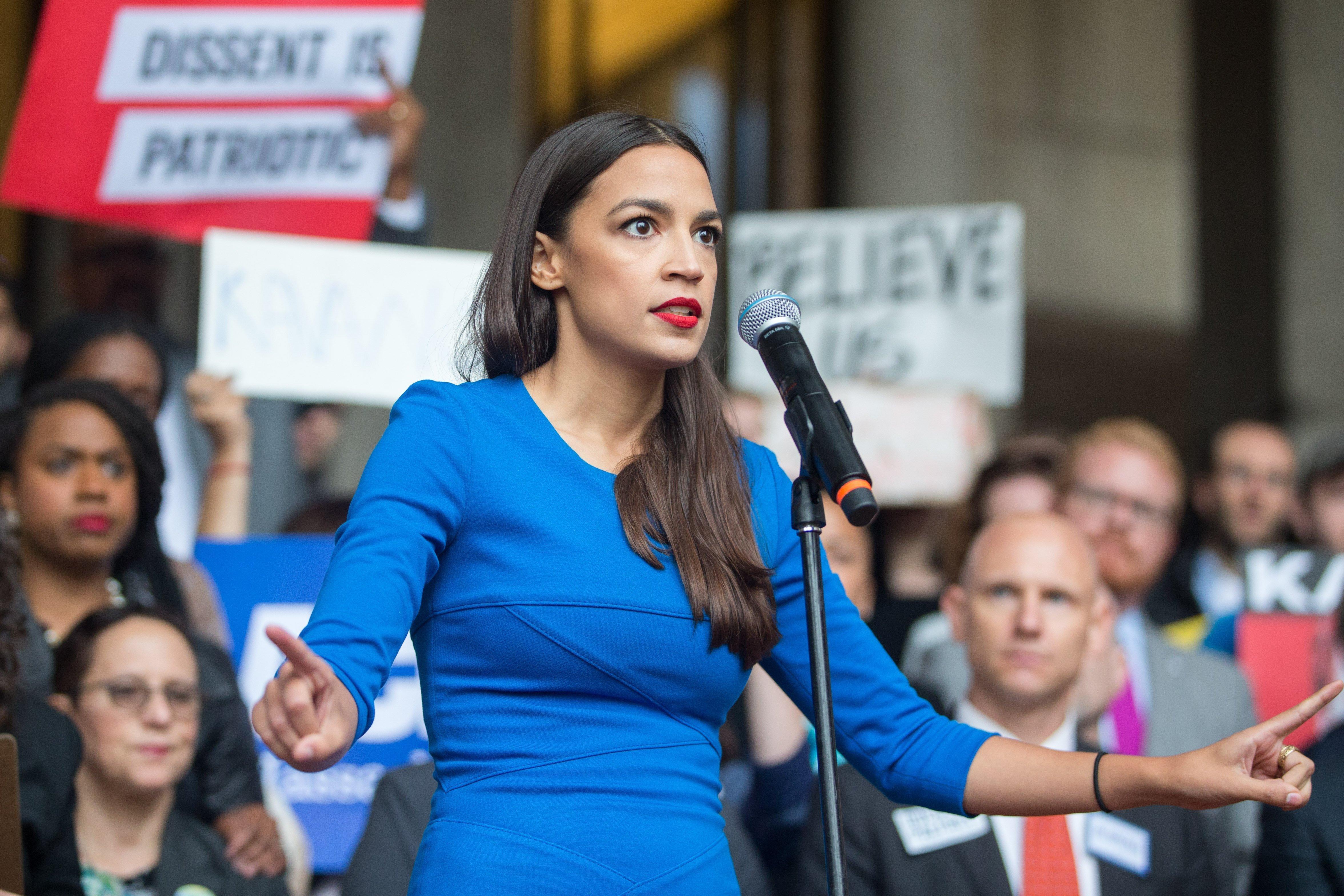 Alexandria Ocasio-Cortez giving a campaign speech | Photo: Getty Images