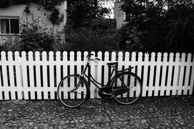 Bicycle parked in front of fence | Source: Pexels