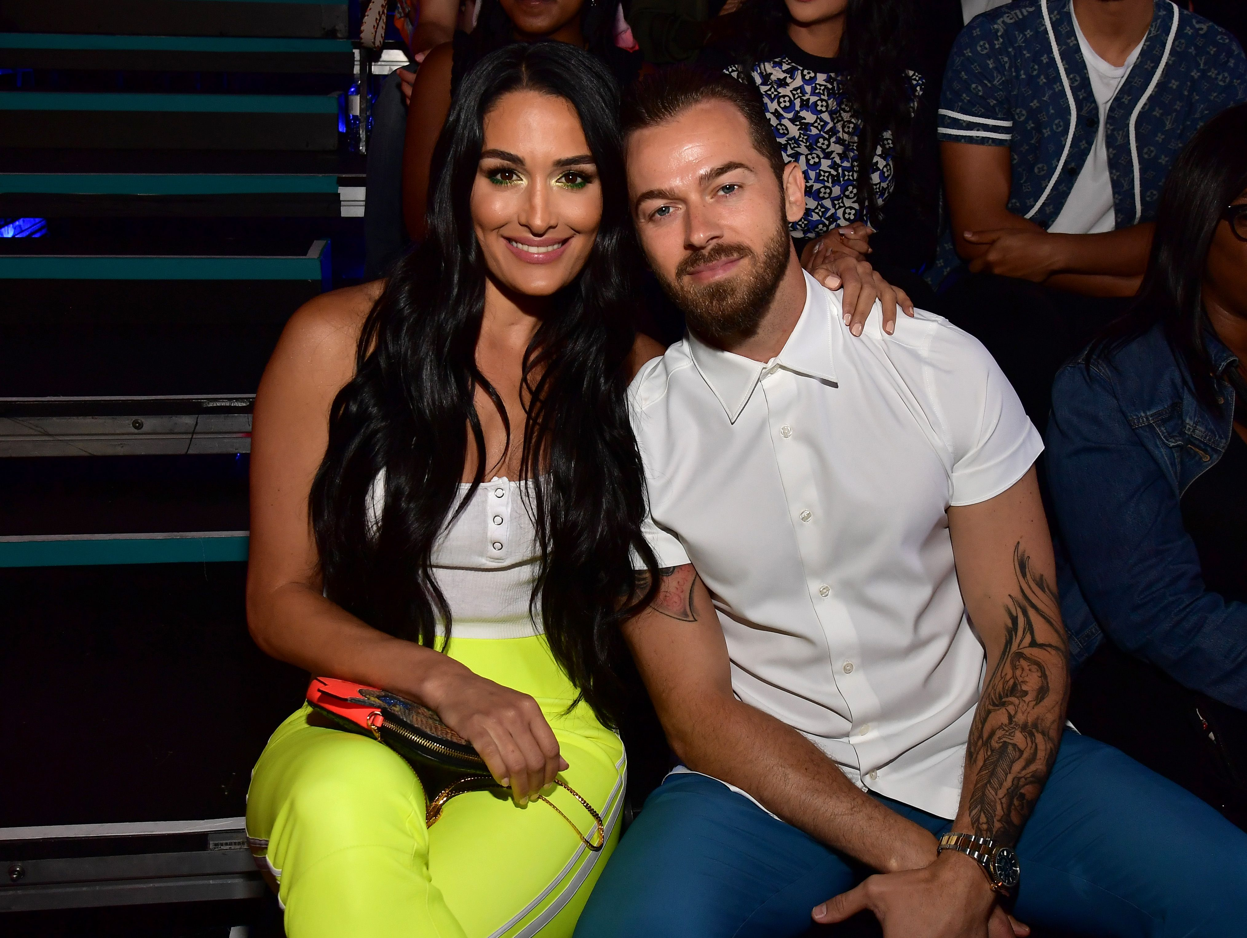 Nikki Bella and Artem Chigvintsev at Nickelodeon Kids' Choice Sports 2019 at Barker Hangar on July 11, 2019. | Photo: Getty Images
