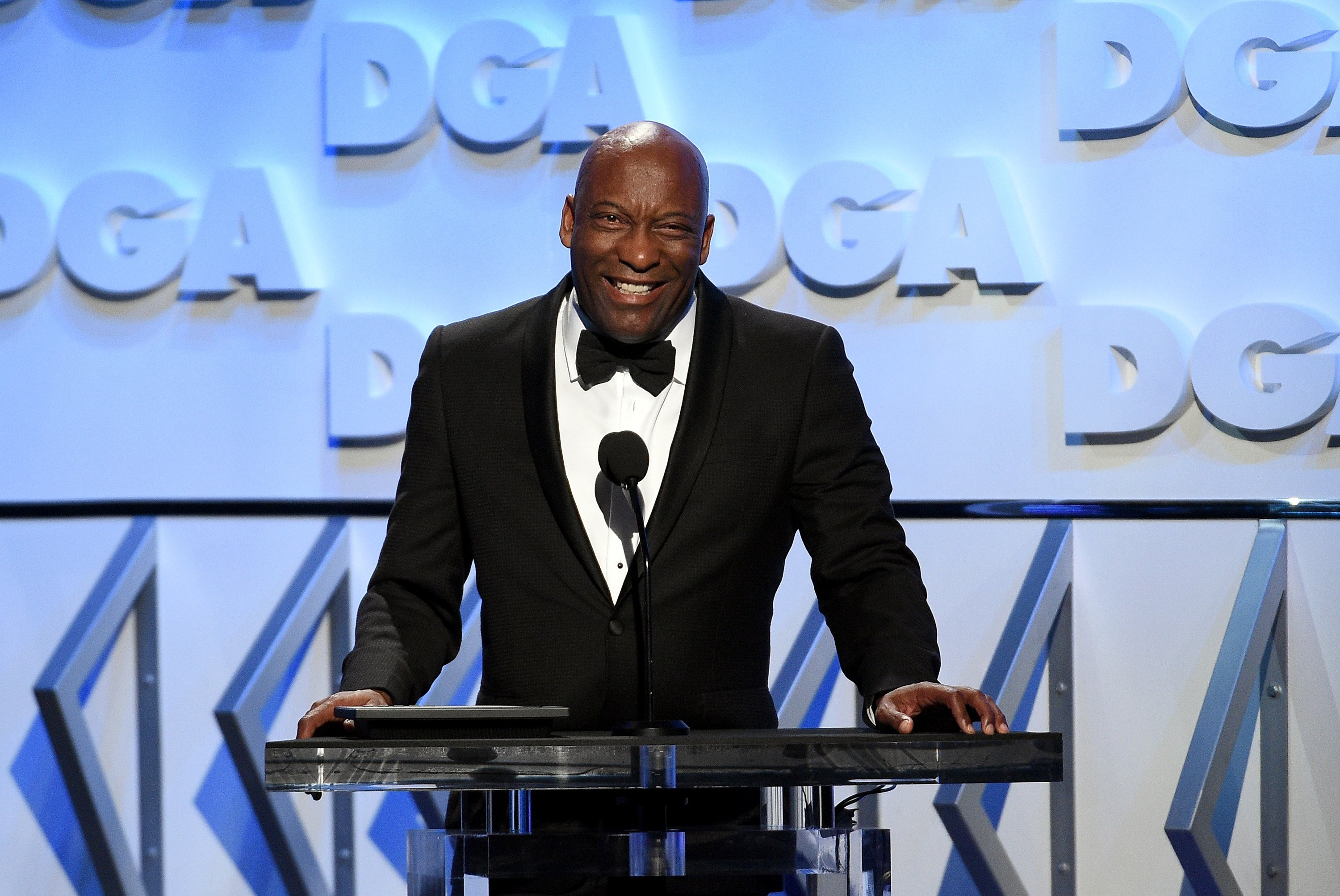 John Singleton speaking onstage during the 70th Annual Directors Guild Of America Awards in California on Feb. 3, 2018. | Photo: Getty Images