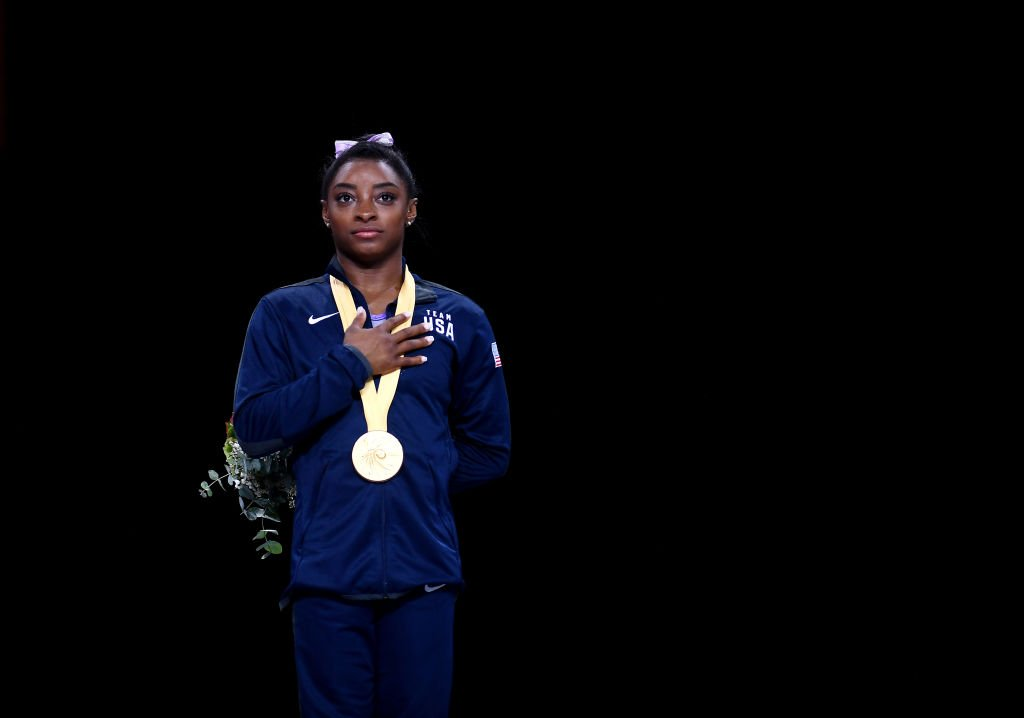 Simone Biles with her gold medal for the Women's Floor Final during the 49th FIG Artistic Gymnastics World Championships in Stuttgart, Germany on October 13, 2019. | Photo: Getty Images