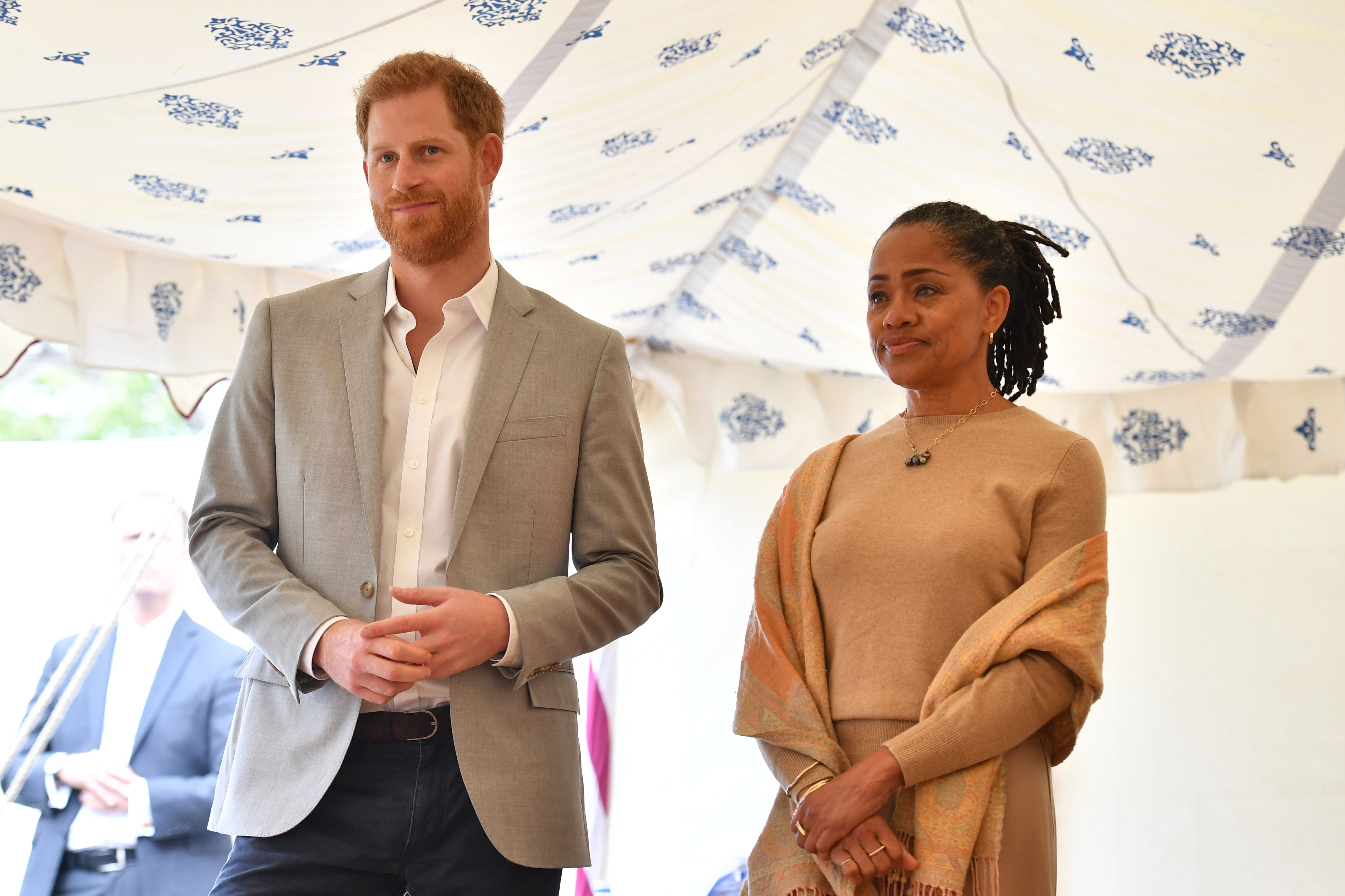 Prince Harry and Doria Ragland listen to Meghan, speaking at an event to mark the launch of a cookbook with recipes from a group of women affected by the Grenfell Tower fire at Kensington Palace on September 20, 2018 in London, England | Photo: Getty Images