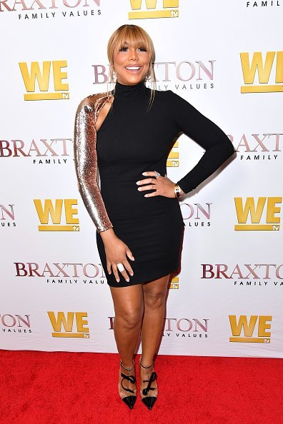 Tamar Braxton ay the premiere of 'Braxton Family Ties' | Photo: Getty Images