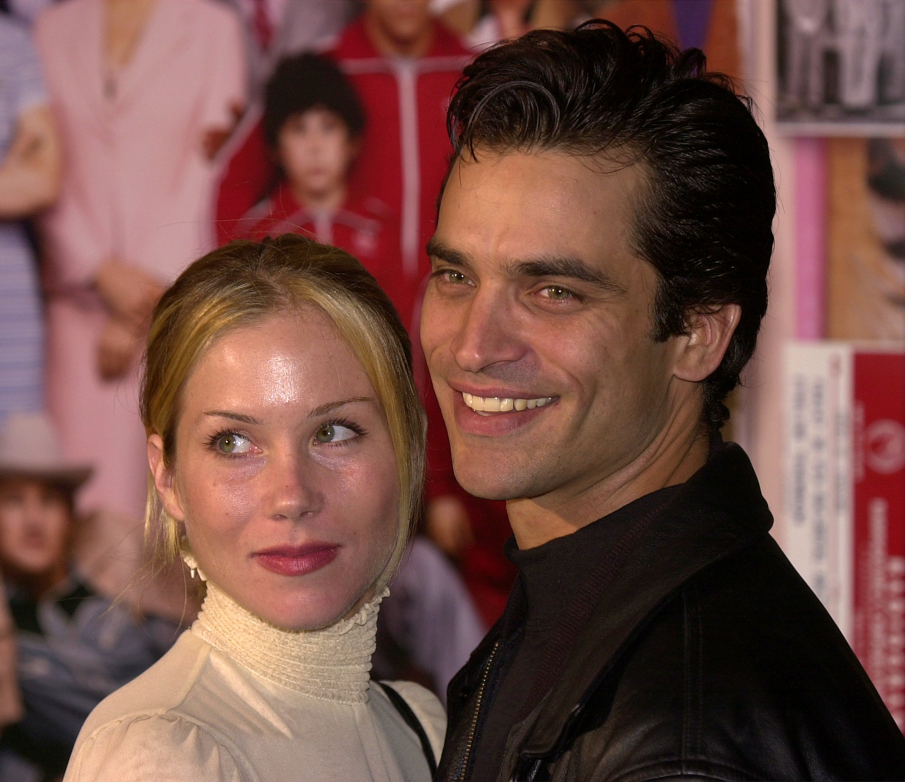 "Christina Applegate (L) and husband Johnathon Schaech attend the premiere of the film ""The Royal Tenenbaums"" December 6, 2001, in Hollywood, CA. 