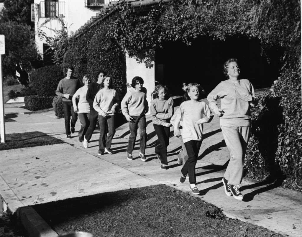 Ann B. Davis leads the Brady family in a rigorous jog in a still from the television series, 'The Brady Bunch,' 1972.  | Getty Images