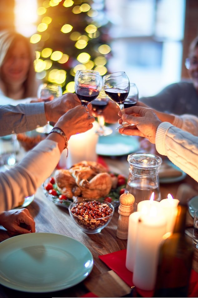 A group of people sipping wine at luchlunch   Photo: Unsplash