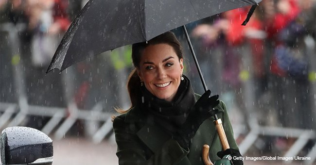 Kate Middleton Keeps Smiling despite Pouring Rain and Dazzles in Classy Olive Green Coat