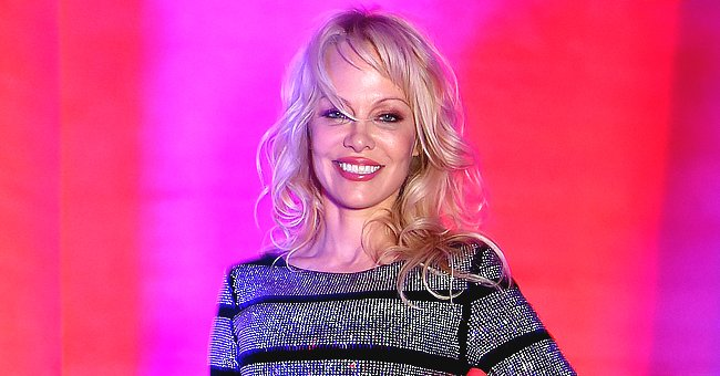 Pamela Anderson Admits Missing Her Sons While Posing on the Bed in a Satin Dressing Gown