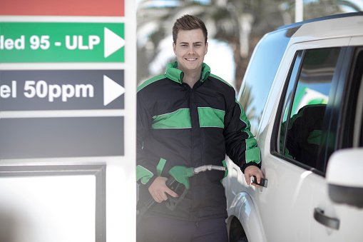Photo of petrol attendant fueling car | Photo: Getty Images