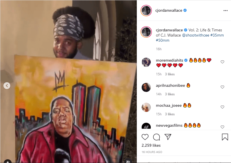 CJ Wallace poses with a portrait of his late dad, Notorious B.I.G in an Instagram video | Source: instagram.com/cjordanwallace