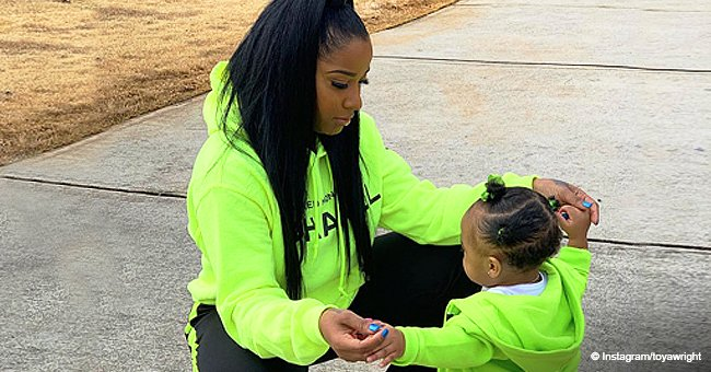 Toya Wright's daughter Reign looks like mom as they stroll in matching neon green outfits