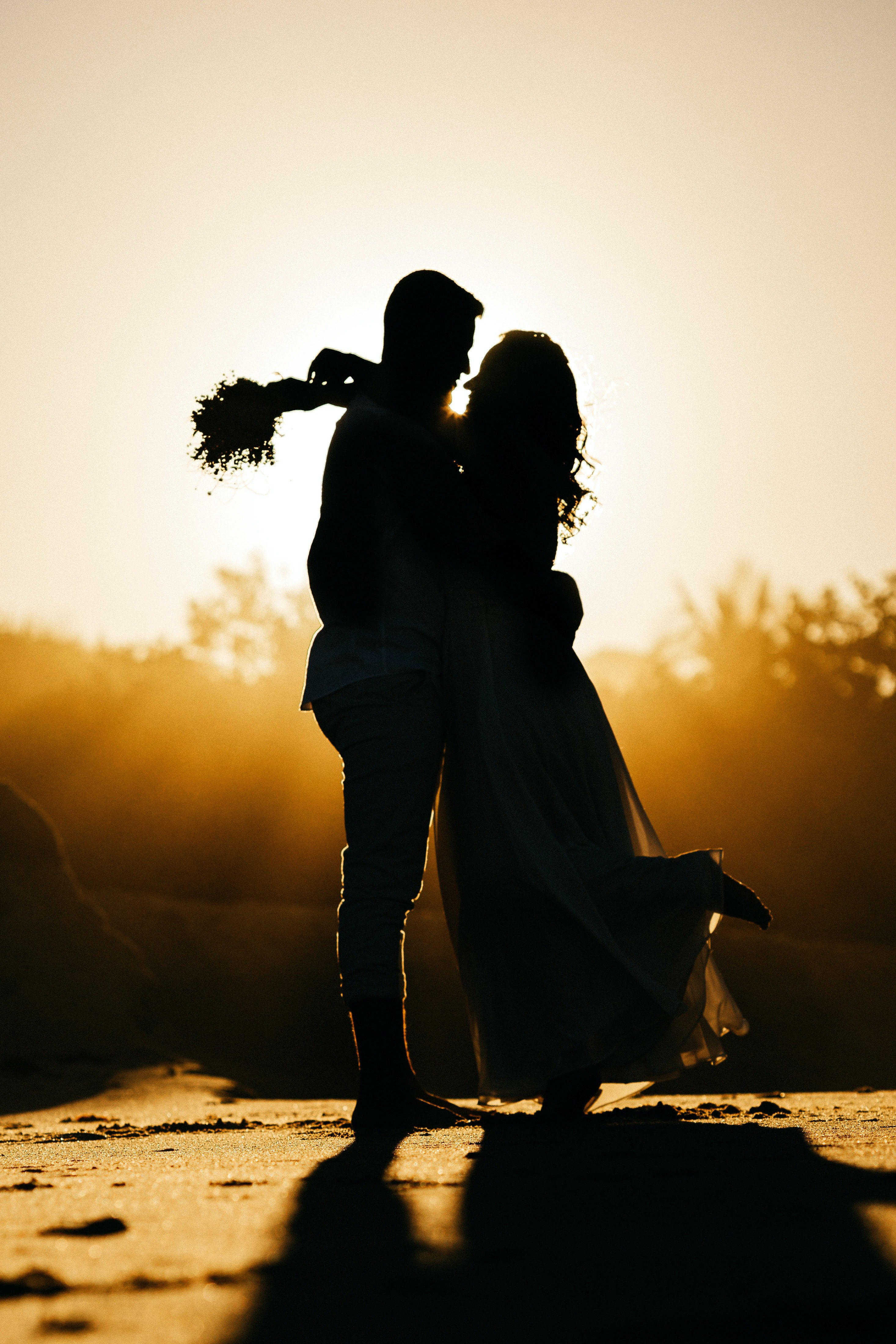 A couple sharing a romantic moment at sunset   Source: Pexels