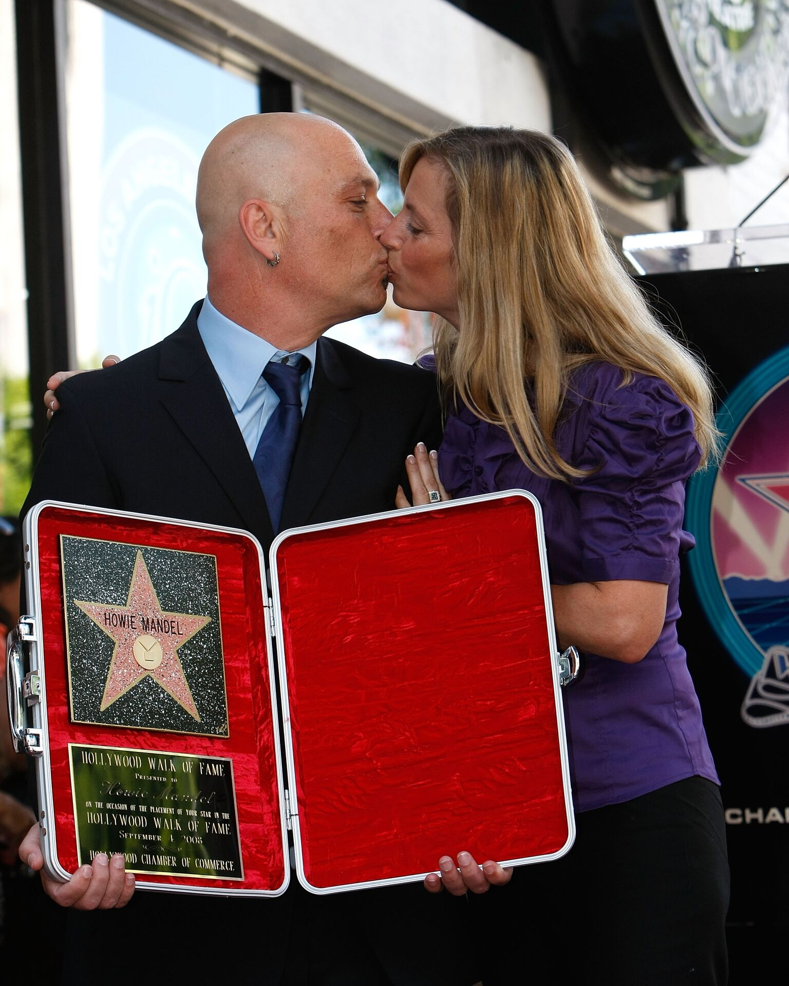 Comedian Howie Mandel and wife Terry Soil pose with Mandel's star on the Hollywood Walk of Fame | Getty Images