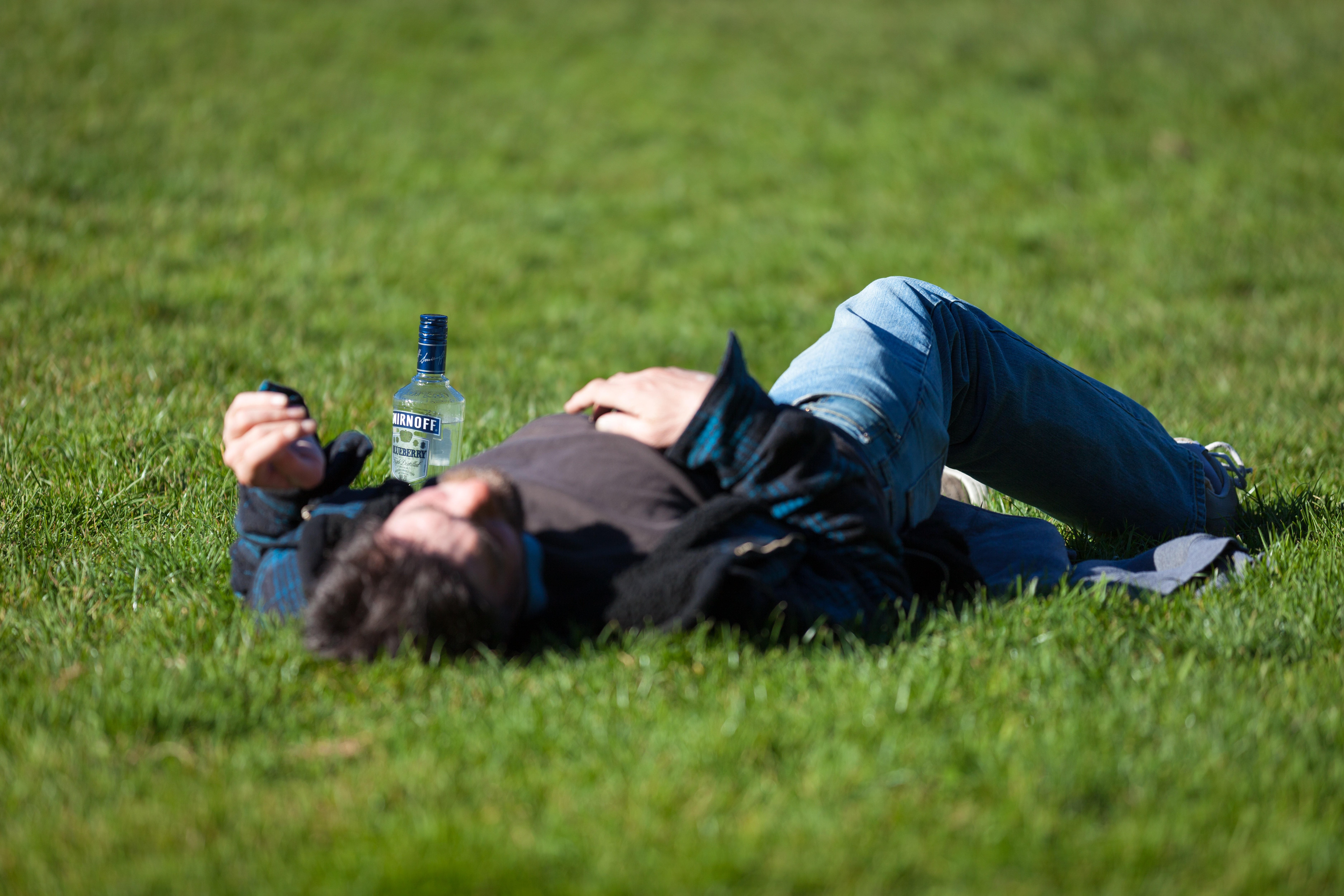 Drunk man passed out in a park. | Source: Unsplash