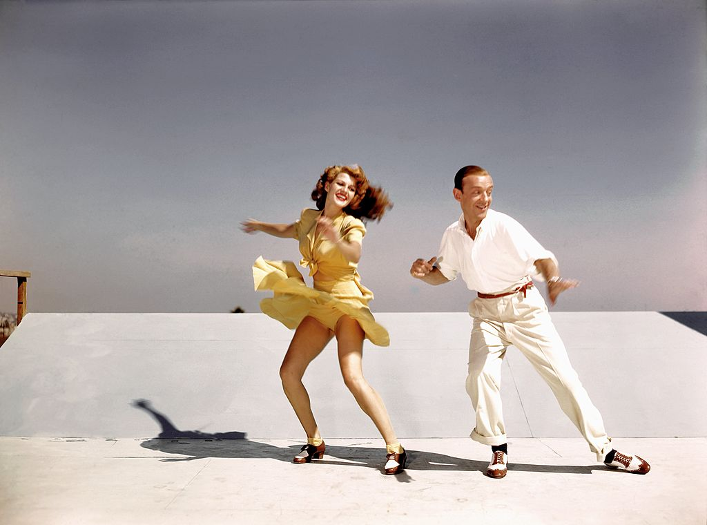 Rita Hayworth and Fred Astaire rehearse on a roof top at Columbia Pictures for a scene from their film 'You Were Never Lovelier' in 1942 in Los Angeles, California.   Source: Getty Images