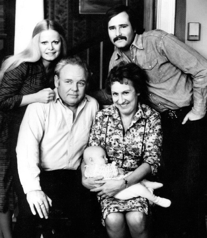 """All in the Family"" cast of 1976. Standing are Sally Struthers (Gloria) and Rob Reiner (Michael); seated are Archie (Carroll O'Connor) and Edith (Jean Stapleton), who is holding the child who played the Bunker's grandson, Joey. 