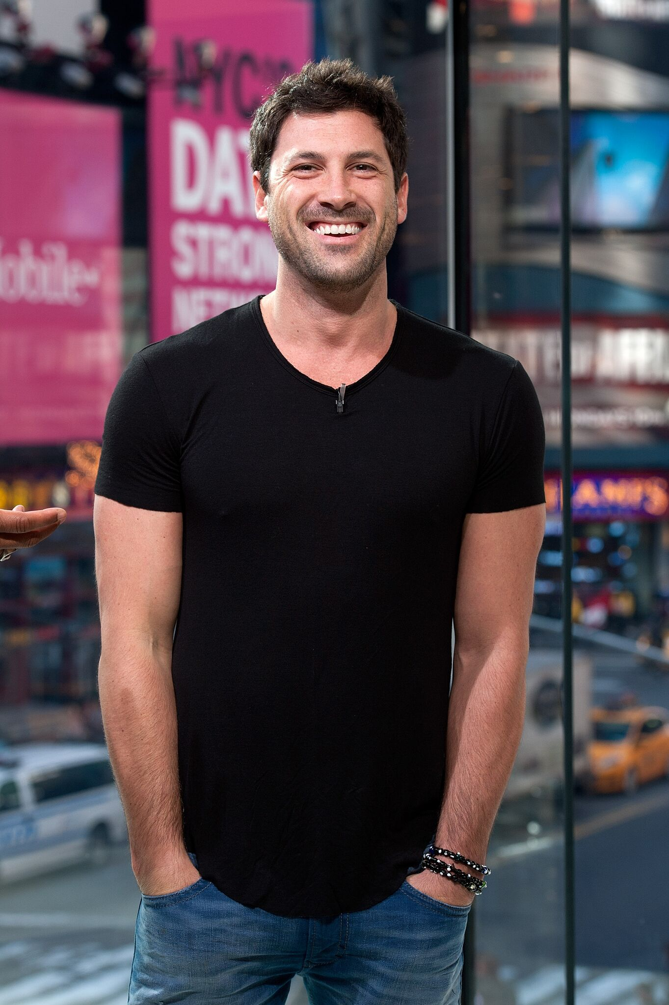 """Maksim Chmerkovskiy visits """"Extra"""" at their New York studios at H&M in Times Square on April 13, 2015 