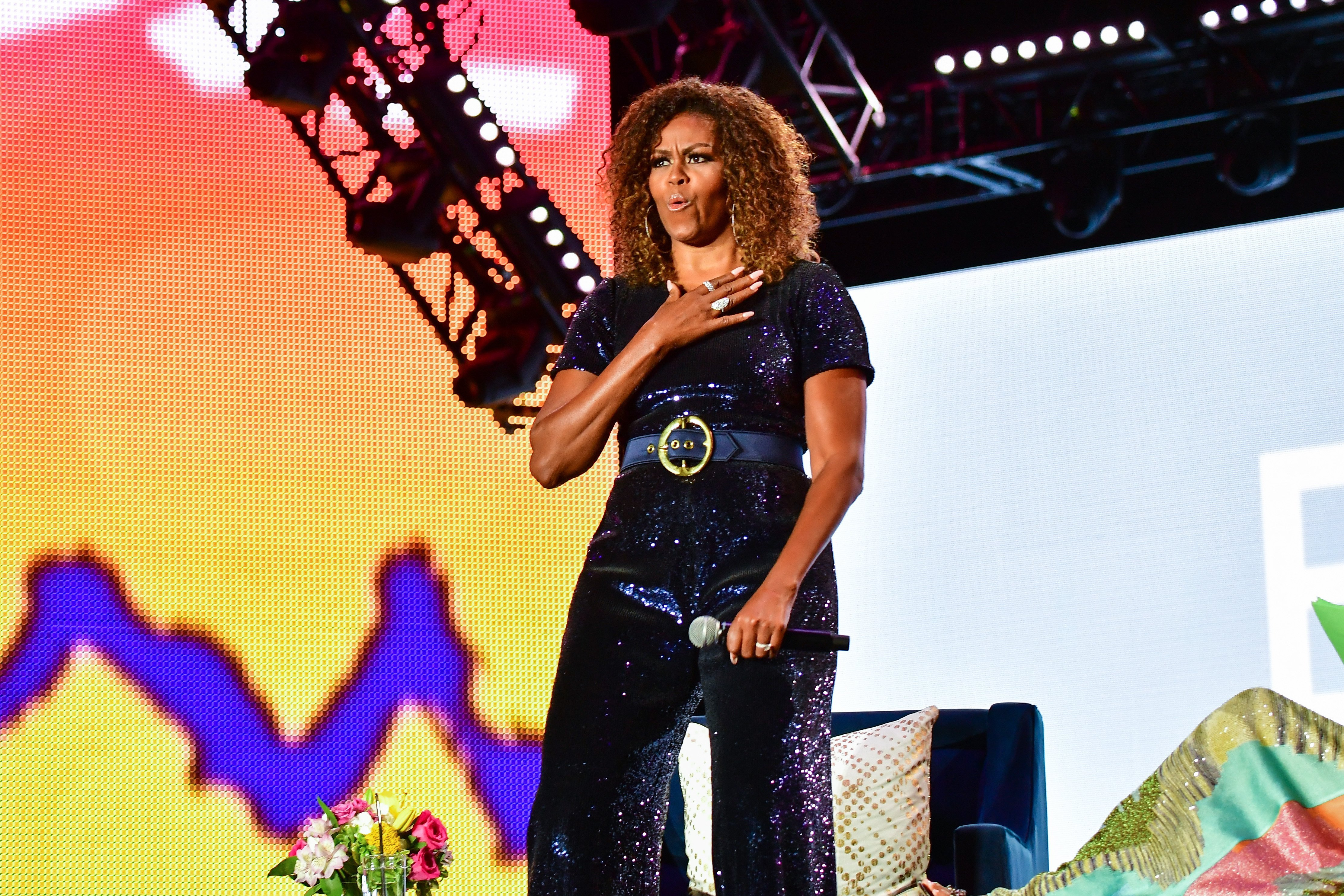 A conversation with Michelle Obama takes place during the 2019 ESSENCE Festival at the Mercedes-Benz Superdome on July 06, 2019.   Photo: GettyImages
