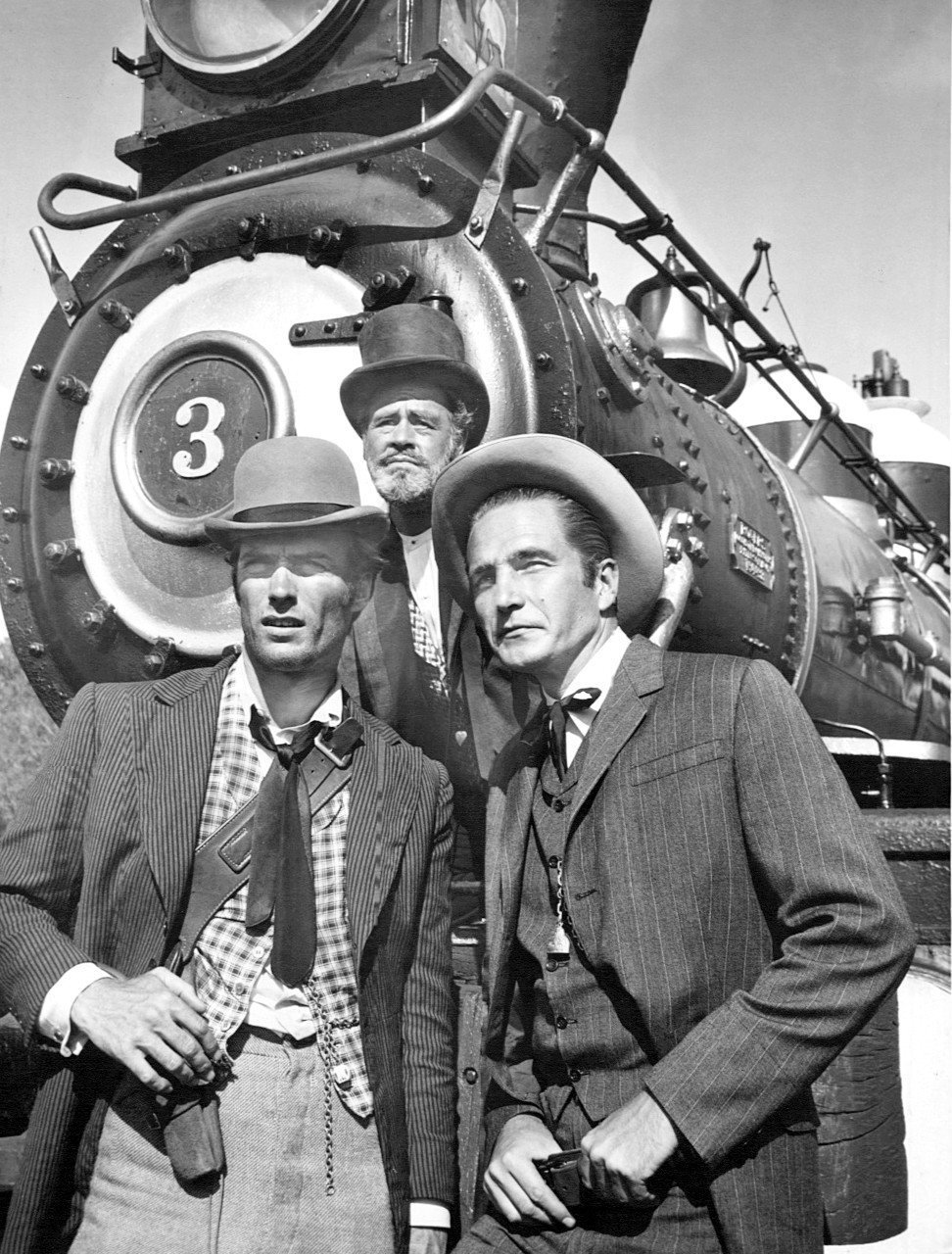 """Photo of Clint Eastwood, Paul Brinegar, and Eric Fleming from the television program """"Rawhide,"""" circa 1950s. 