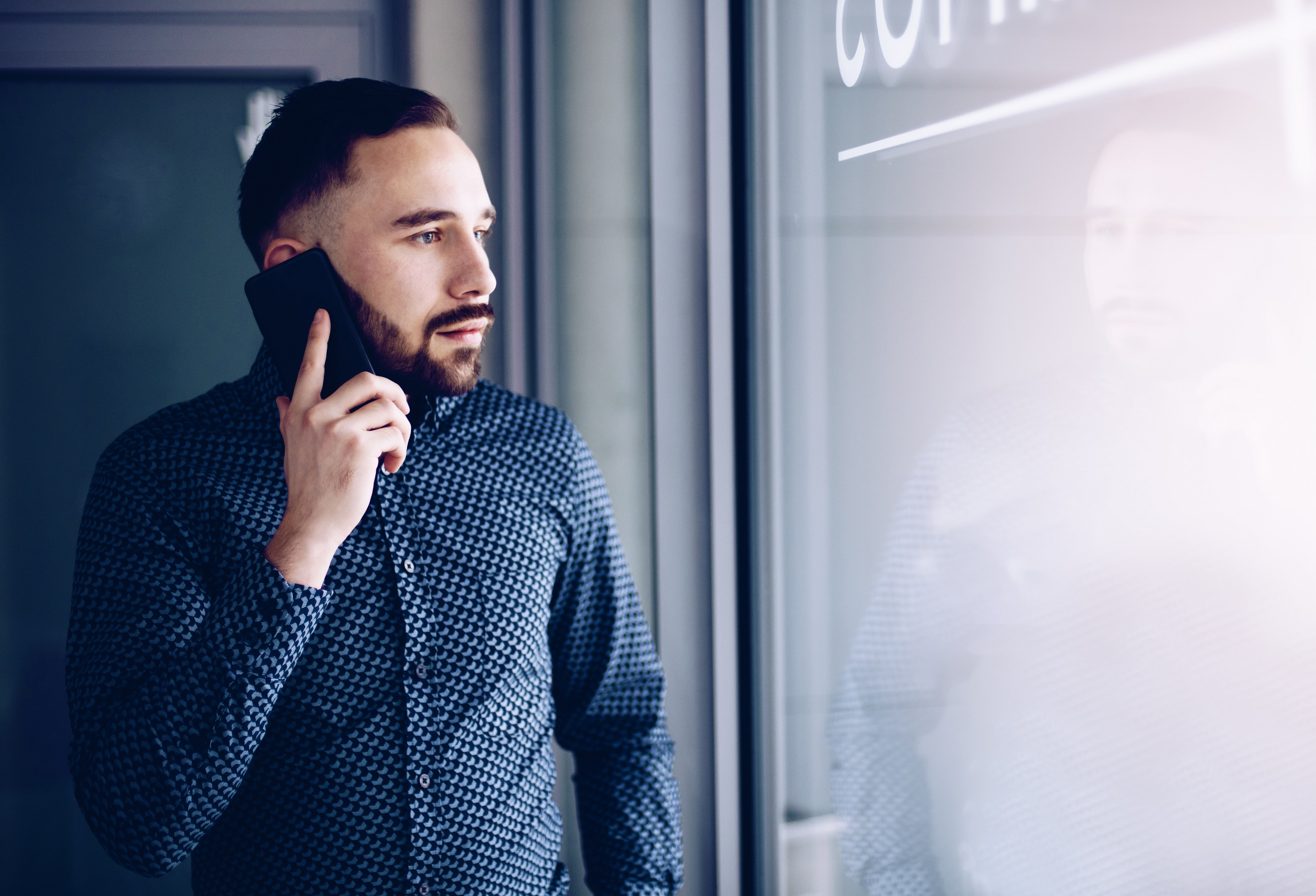Man talking on a phone. Photo: Shutterstock