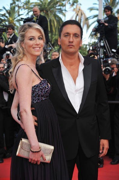 Dany Brillant avec Nathalie Moury au Palais des Festivals lors du 63e Festival de Cannes, France.  | Photo : Getty Images