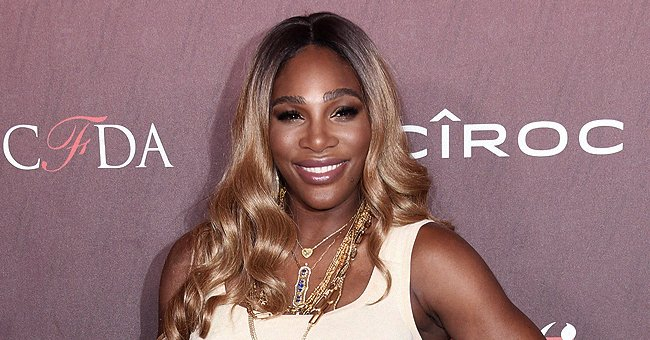Serena Williams Shows off Her Afro & Killer Curves Posing in $50.00 Martina Asymmetrical Sweater Tank in Ivory