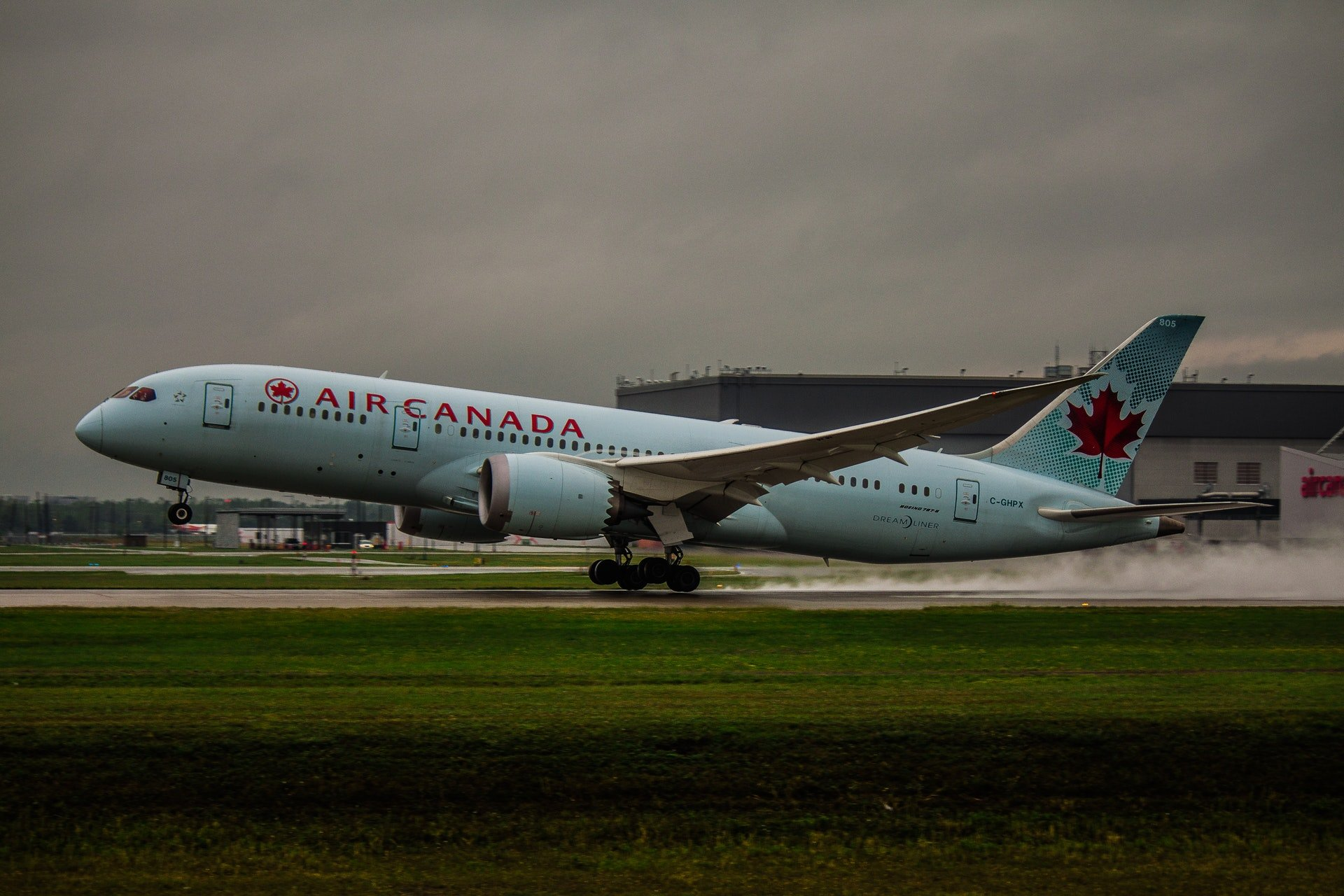 A plane on the tarmac | Photo: Vincent Albos / condowizard.ca