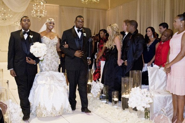 Sons Brentt Leakes and Bryson Bryant walking their mother Nene Leakes down the aisle | Photo: Getty Images