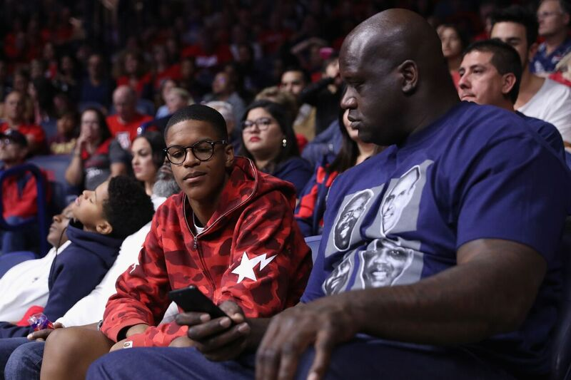 Shaquille and Shareef O'Neal sit courtside at an NBA game | Source: Getty Images/GlobalImagesUkraine